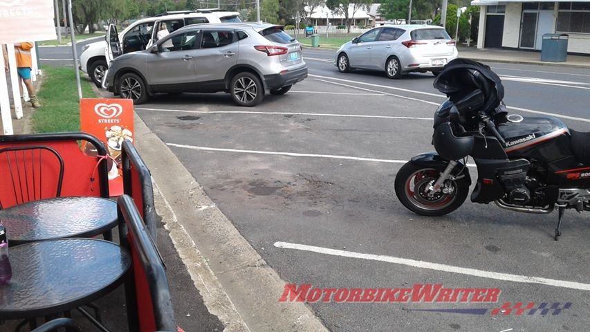 Toowoomba riding trainer Tony Gallagher watched in horror as his Kawasaki ZRX1200R sunk into thin bitumen and tall over in a Crows Nest main street parking bay.