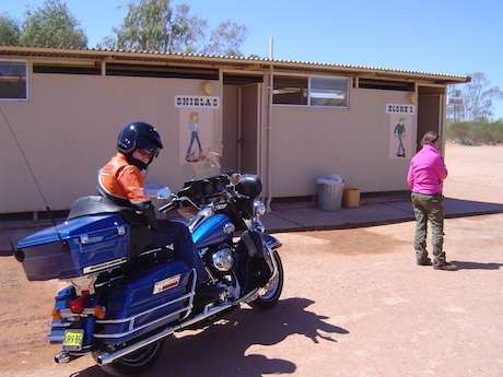 Harley Ultra at a Stuart Highway rest stop speed limit