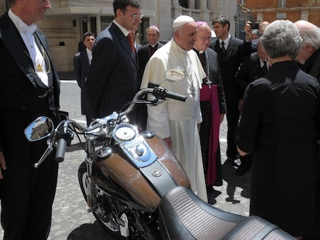 Pope Francis with the Harley Dyna expensive motorcycle holy