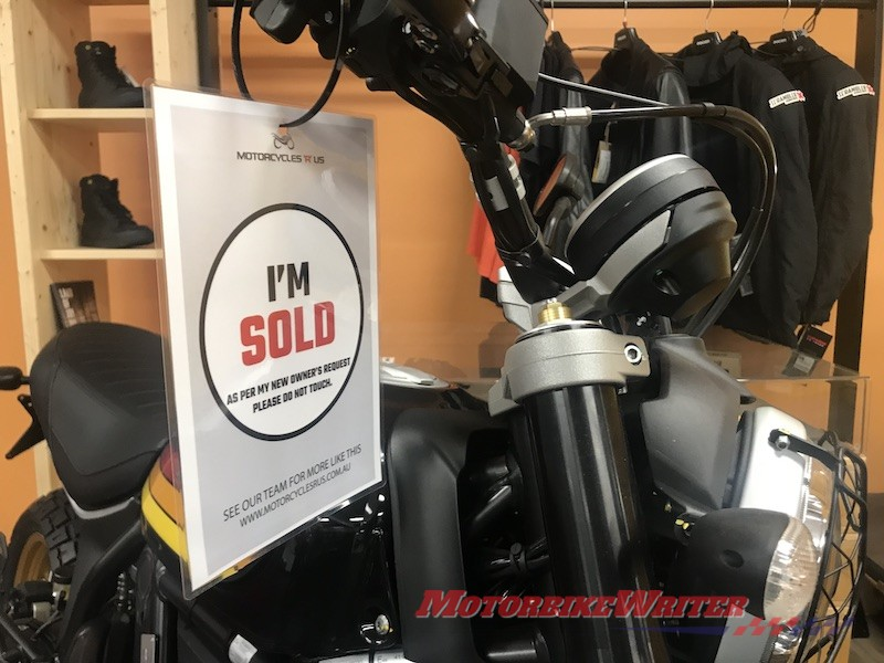 Ducati test ride demo motorcycle sales showroom selling motorcycles pace sales slide