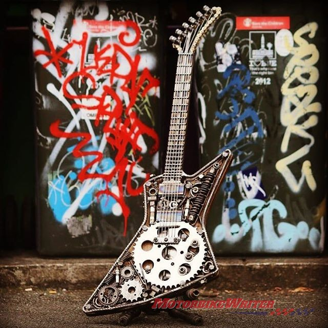 Artist Paul Tinson uses motorcycle parts for guitar sculptures guitars