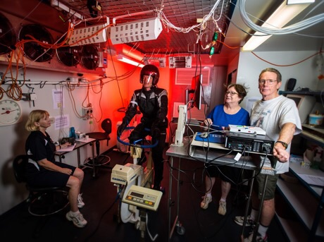 Testing motorcycle in the thermal chamber (from left) research assistant Liz Taylor, volunteer rider Dr Greg Peoples, Liz de Rome and Nigel Taylor. rating award