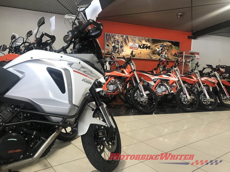 KTM test ride demo motorcycle sales showroom selling motorcycles spiral