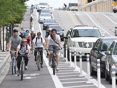 Cyclists in bike lanes ride to work day lane filtering bus lanes reward