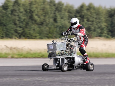 Matt McKeown (Plymouth) on his jet powered shopping trolley set an unofficial world record of 61.18mph (photo Steve McDonald) wheelie