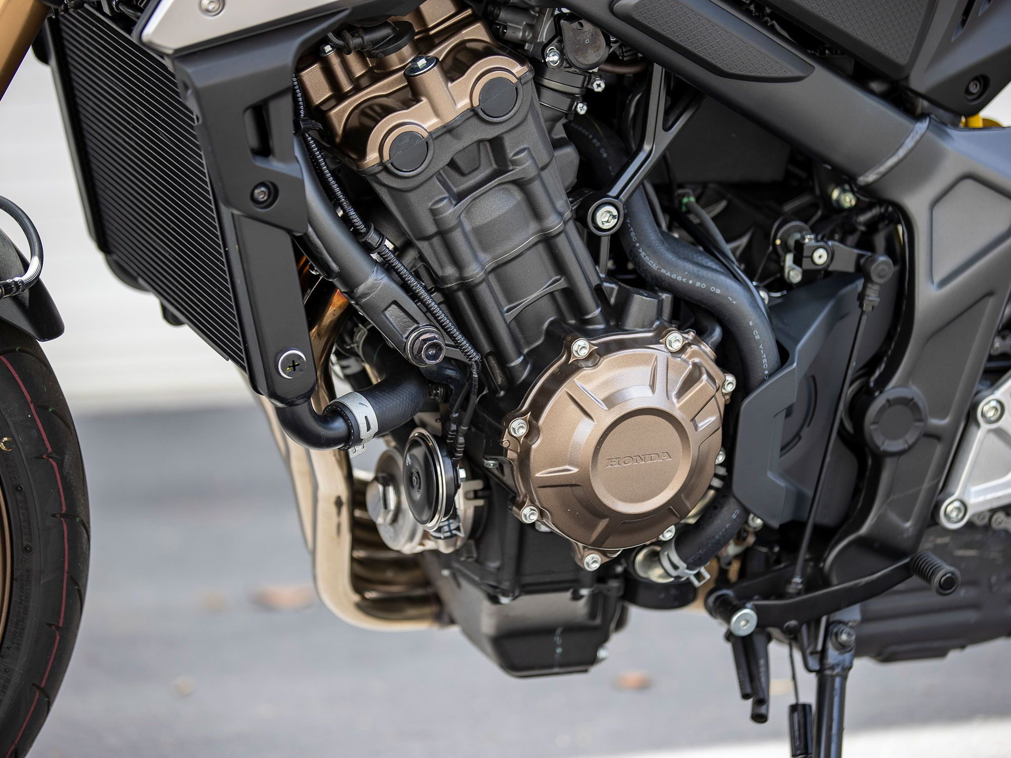Powering the CB650R is a 649cc inline-four engine. While the bore measurement is identical to the competition-inspired CBR600RR, Honda increased the stroke to achieve the displacement.