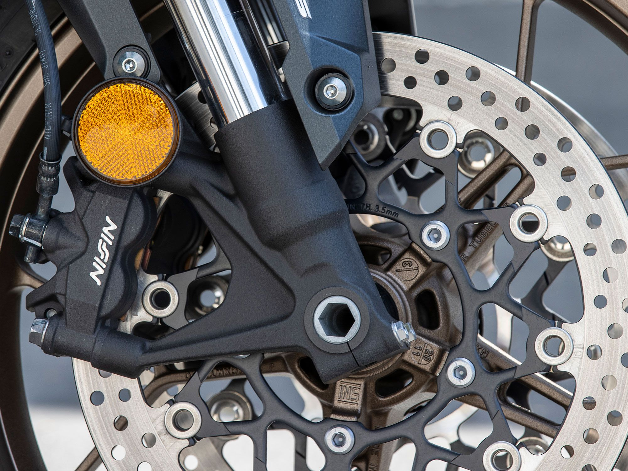 A pair of four-piston Nissin calipers clamping to 310mm discs bring the CB650R to a halt, even if lack of feel at the kever hinders their true stopping potential.