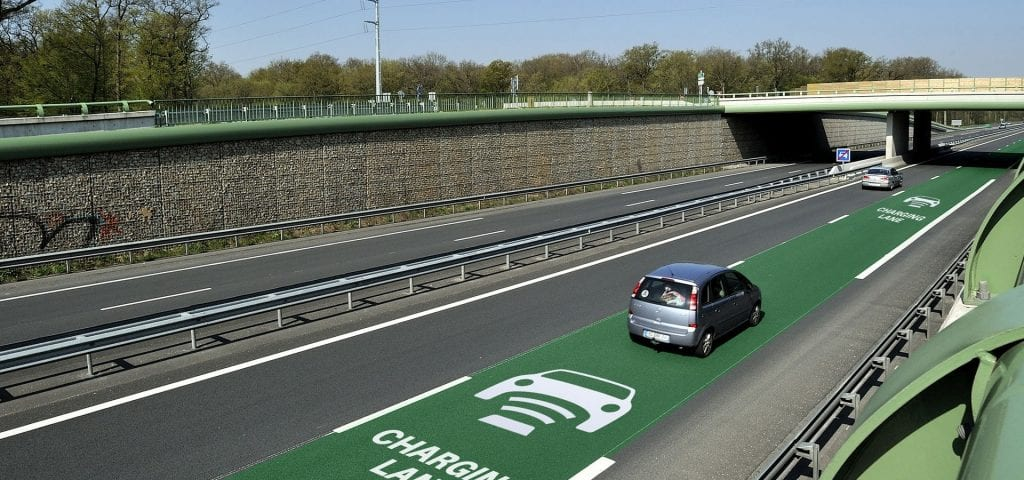 a car travelling along an inductive highway for a quick charge.