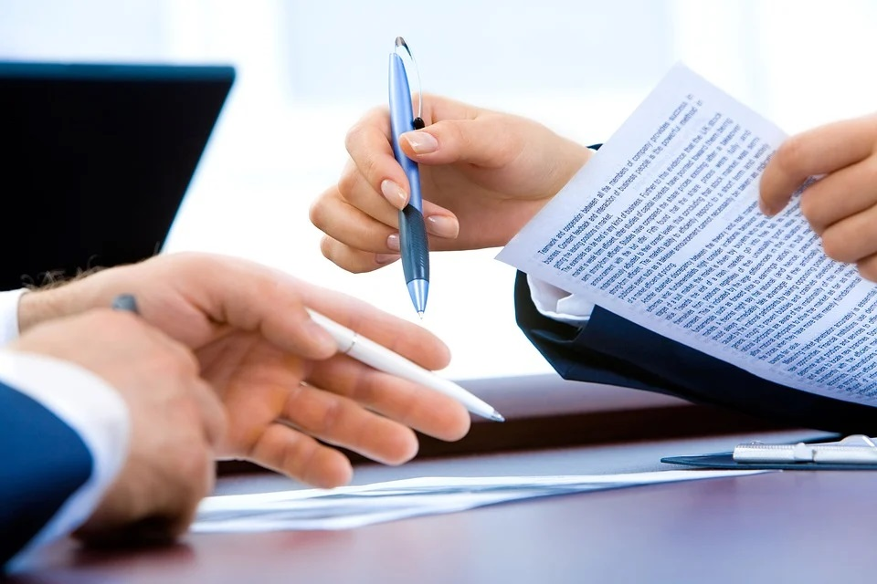 Signing forms at a table