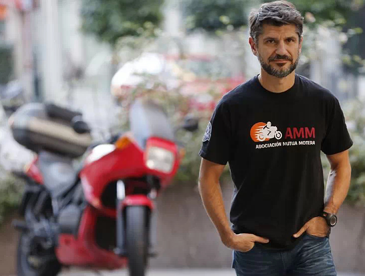 Juan Manuel Reyes, AMM President, in front of a motorcycle