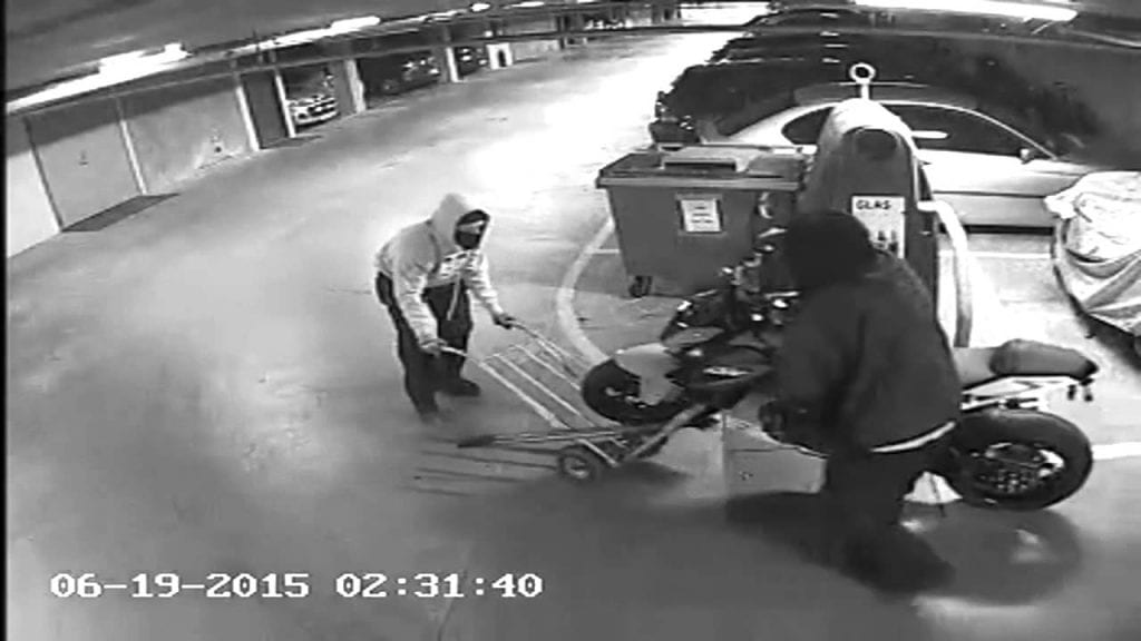 security footage of a motorcycle being stolen