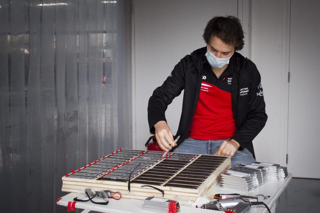 A student from Electric Superbike Twente testing battery components for the new electric Superbike, dubbed the Delta-XE