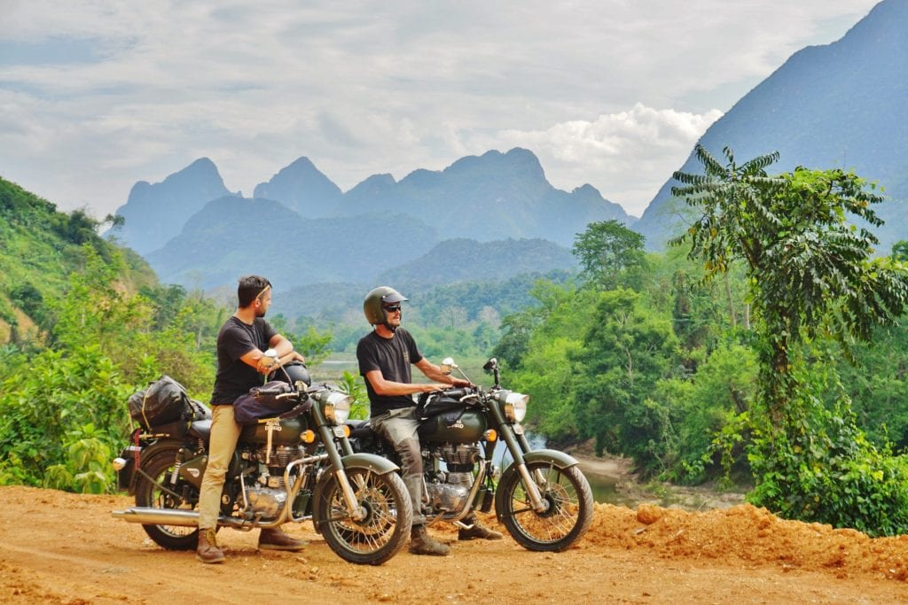 Two riders enjoy the view in Laos
