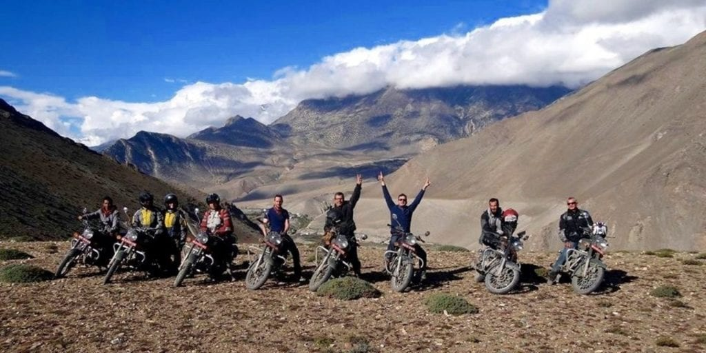 a group of riders enjoying their travels through Nepal