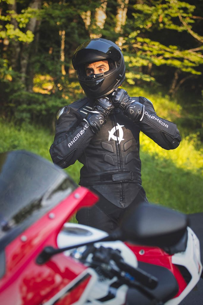 a man trying on the all-=new, vegan, environmentally friendly Andromeda NearX motorcycle suit