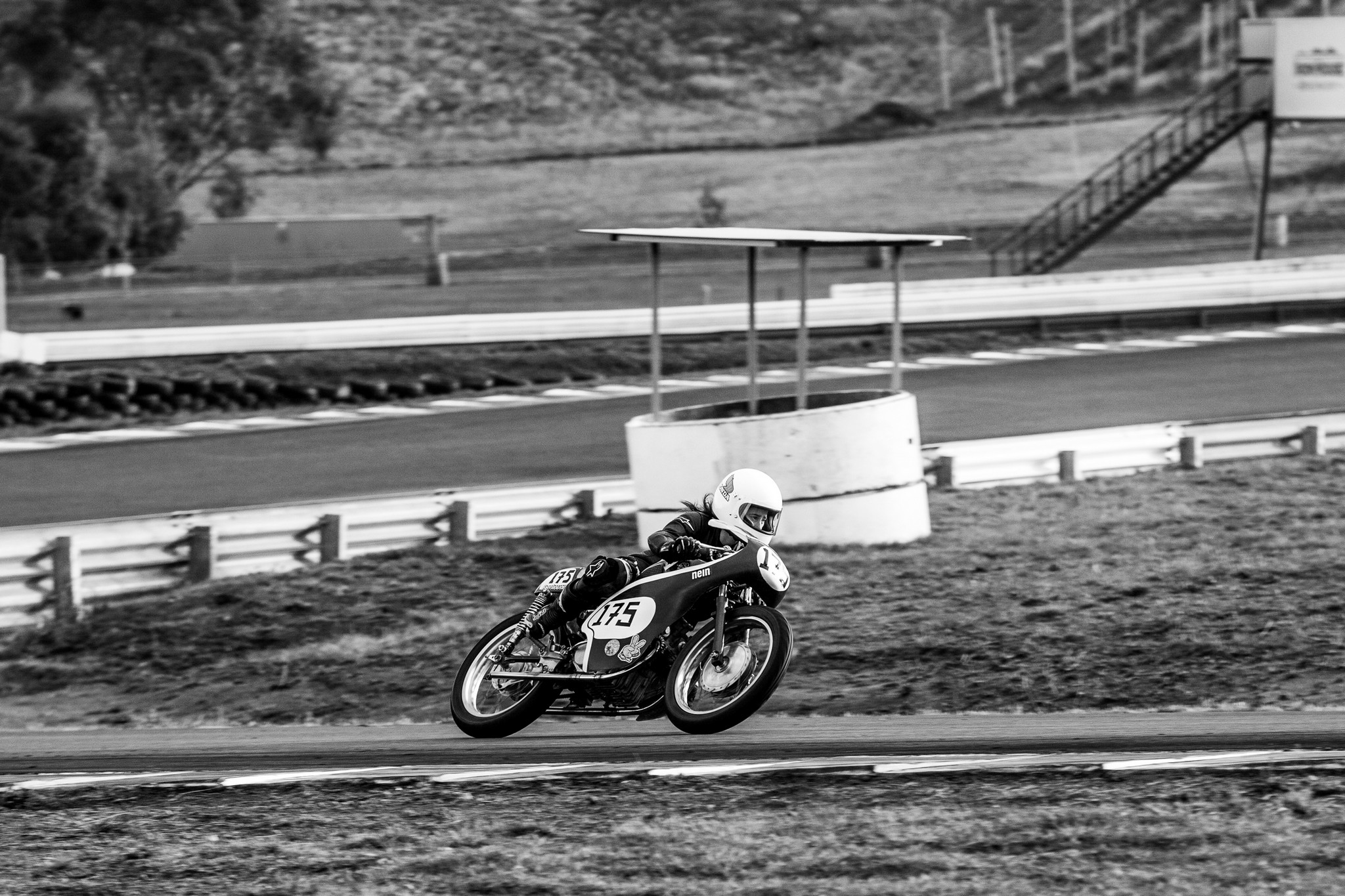 Black and white photo of a racing motorcycle at Tasmania's Baskerville Racetrack