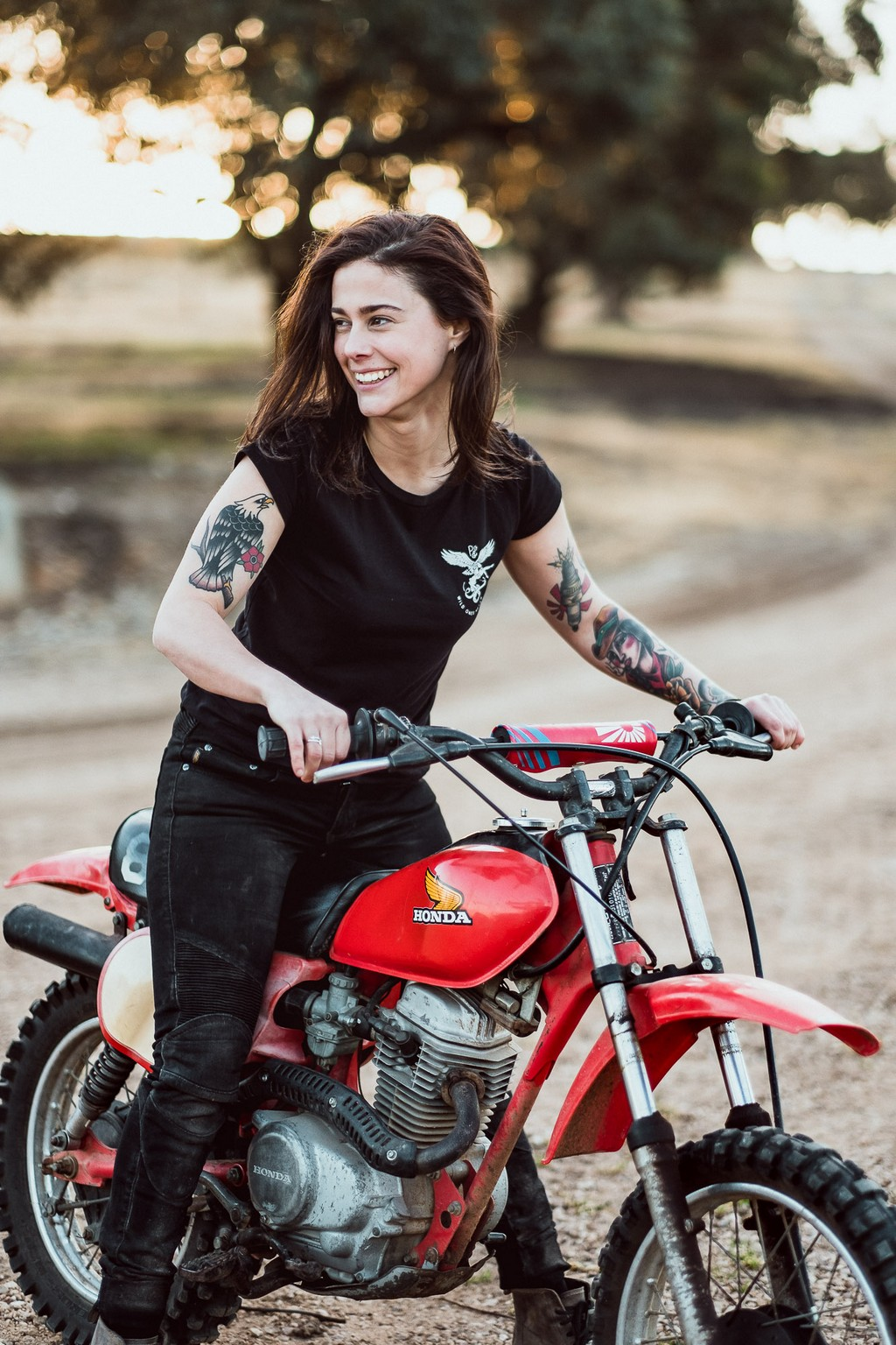 Katie Adbilla on a Honda XL motorcycle in Tasmania