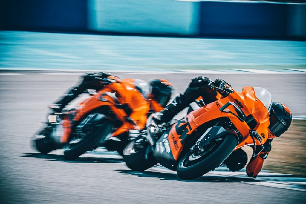 A front view of riders battling on the all-new track-only 2022 KTM RC 8C