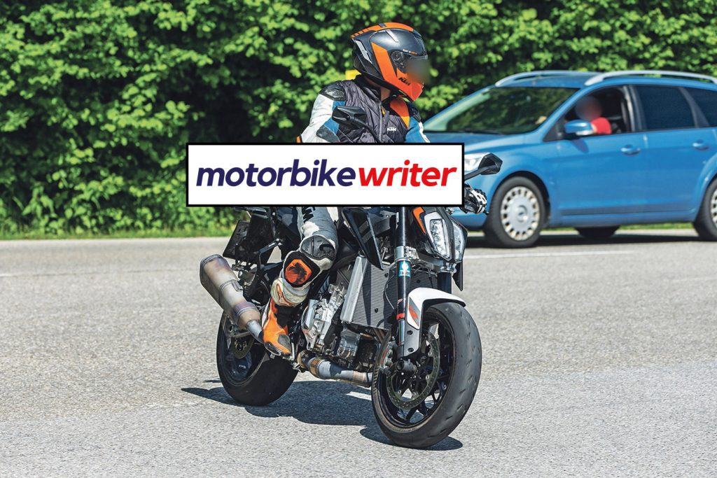 a front right view of spy shots taken of a new KTM machine