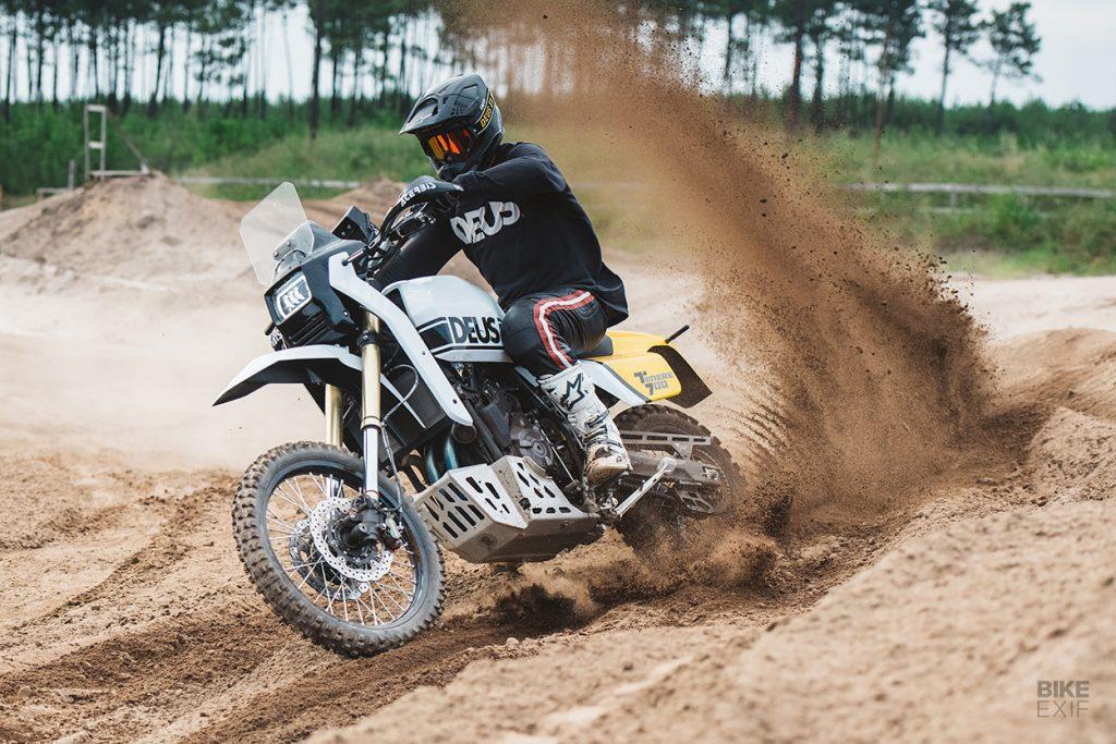 a view of a racer tearing up the dirt on the all-new custom custom Yamaha Ténéré 700, created by Deus Italia