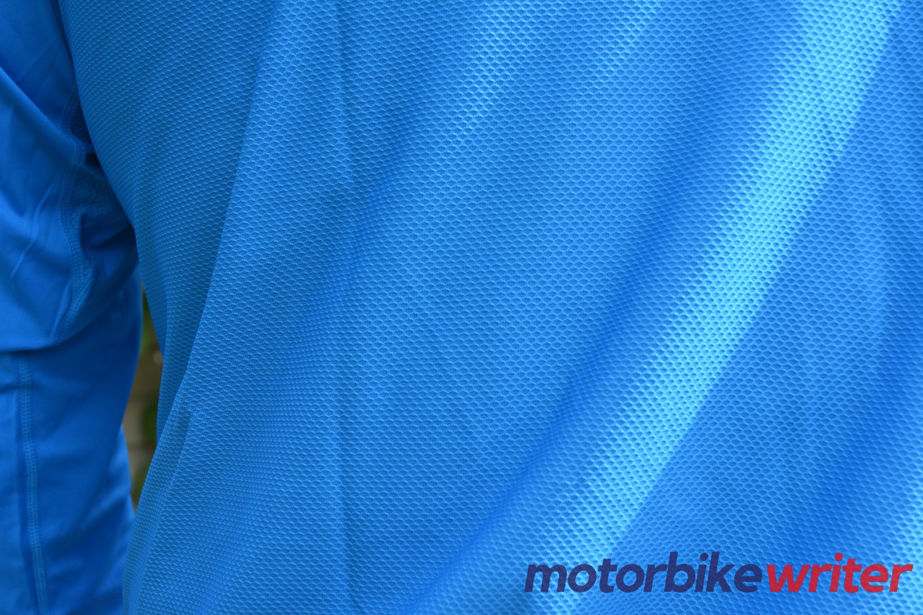 Close-up rear view of blue Fieldsheer Mobile Cooling Long Sleeve shirt