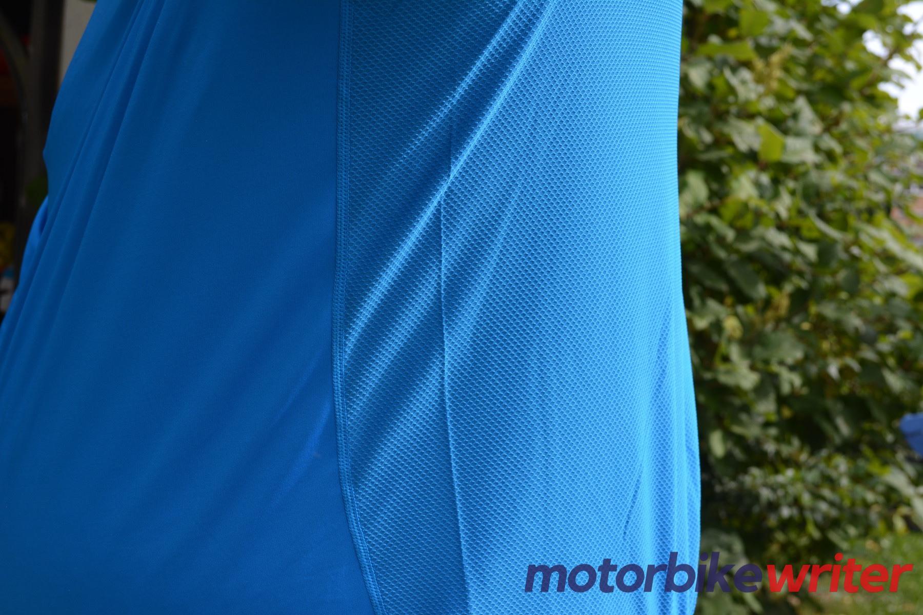 Close-up of side seam on blue Fieldsheer Long Sleeve shirt