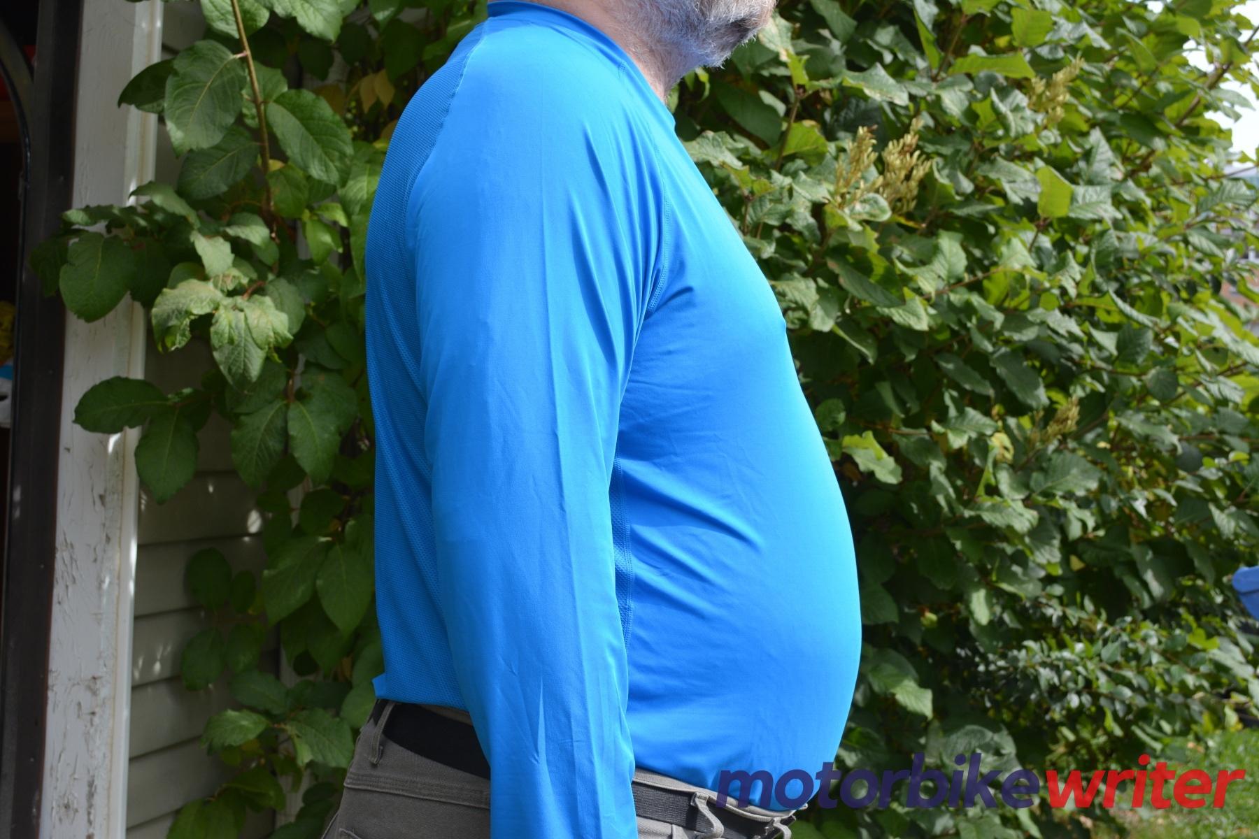 Side view of man wearing Fieldsheer Mobile Cooling Long Sleeve shirt