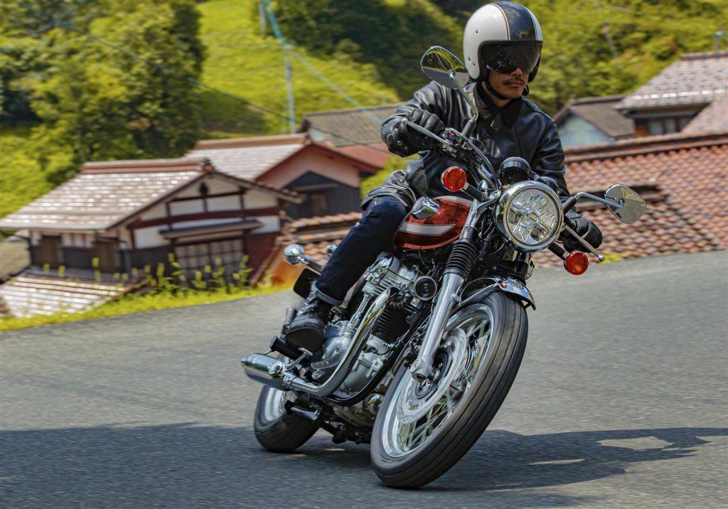 A frontal three-quarter view of a rider enjoying the 2022 Kawasaki W800