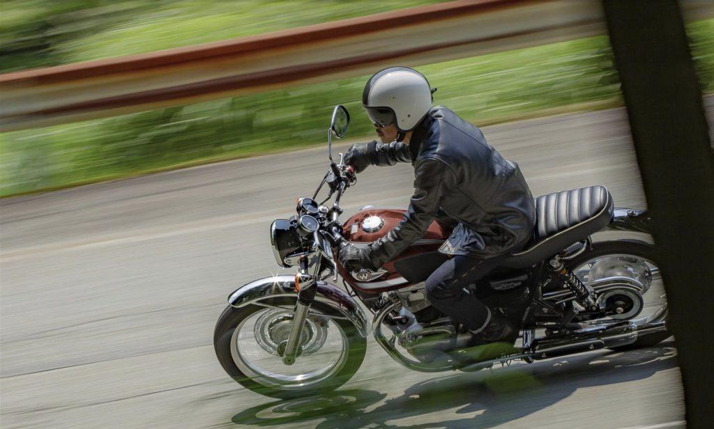 a rider enjoying the 2022 Kawasaki W800 leaning into the twisties